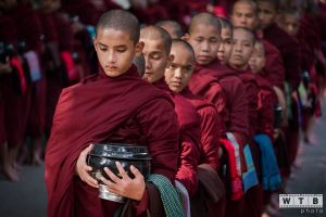 Young Monks Lined Up For Lunch