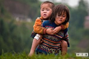 Young Girl Carrying Her Injured Brother